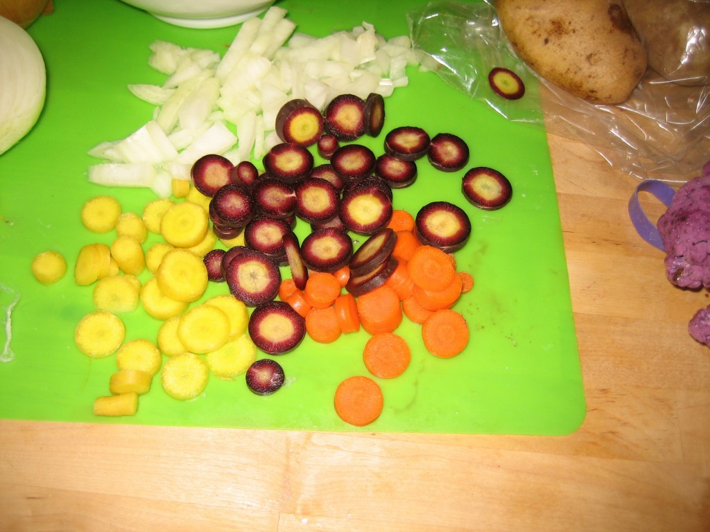 Yellow, orange, and purple carrots. Chopped onions too.