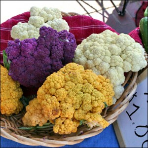 Assorted colorful cauliflowers (orange ones make lots carotenoids the group of molecules that includes pre-vitamin A, the purple ones make anthocyanins another kind of plant pigment). photo: Le Grande Farmers' Market, flickr (click to see photo in its original context)